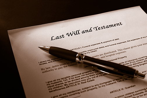 Last Will and Testament document and pen
